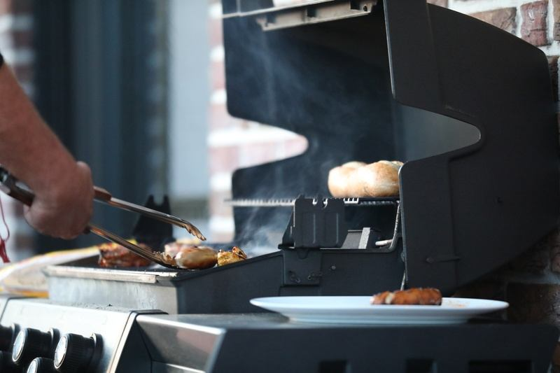 Man Cooking on BBQ