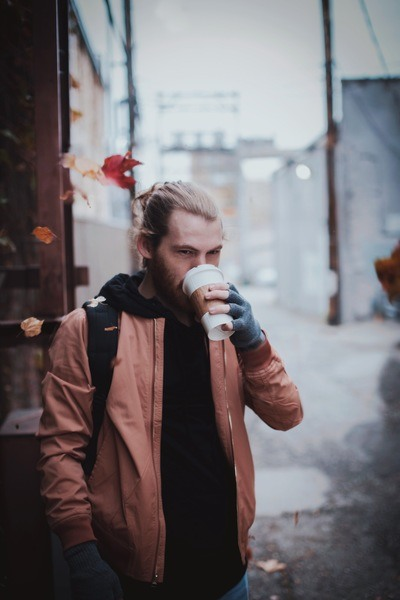 Man Drinking Cup of COffee Selective Focus