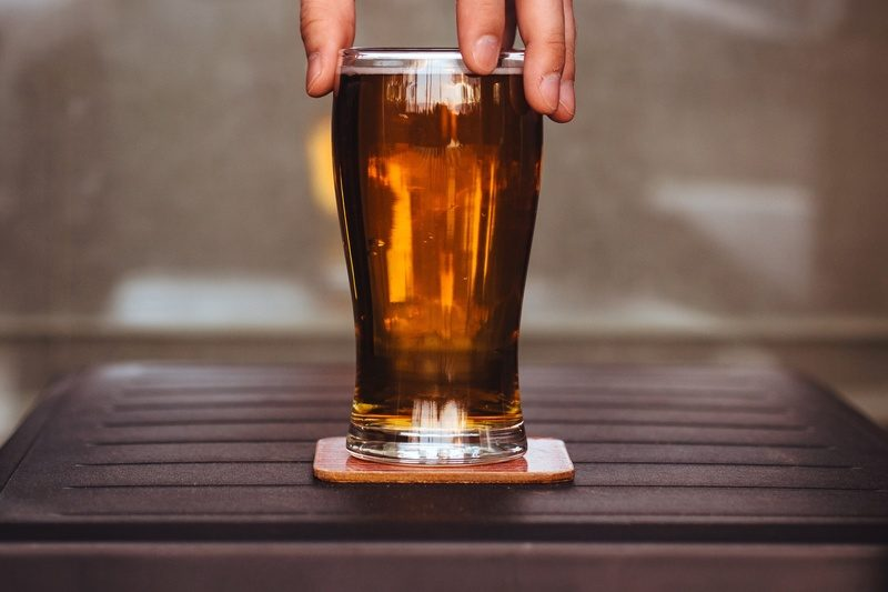 Man Holding Beer Glass