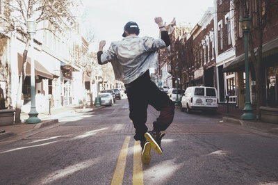 Man Jumping on the Middle of the Street