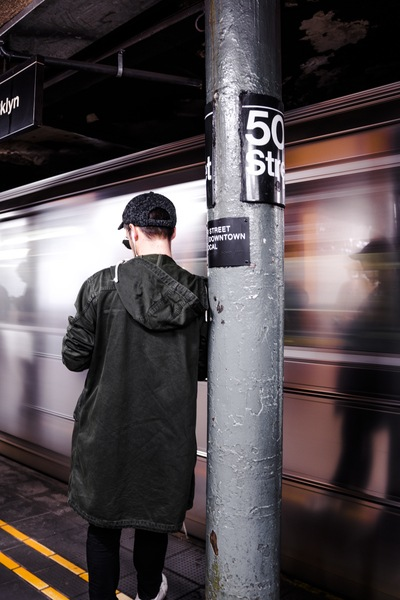 Man Leaning on the Post