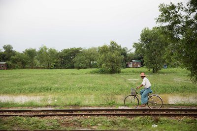 Man On Bike Near Tracks