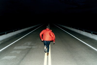 Man Running on Road at Night Time