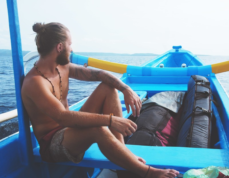 Man Sitting on Boat