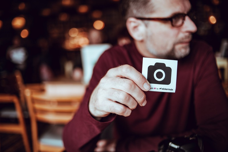 Man Walking A Card with Camera Icon