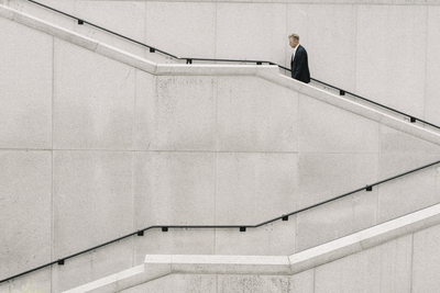 Man Walking on Stair