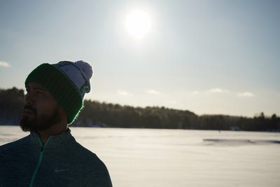 Man Wearing Hat On Sunny Snow Day