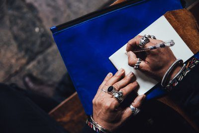 Man With Rings Writing