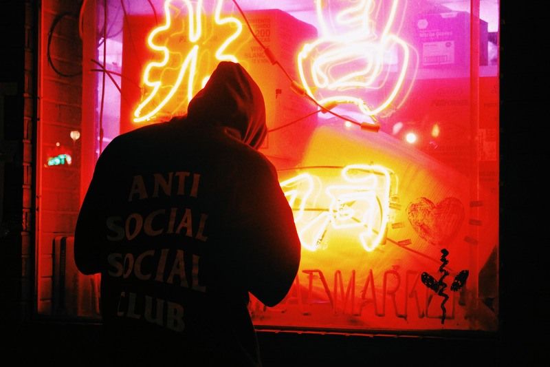 Man by Neon Sign