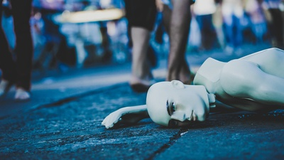 Mannequin Lying Down on Floor