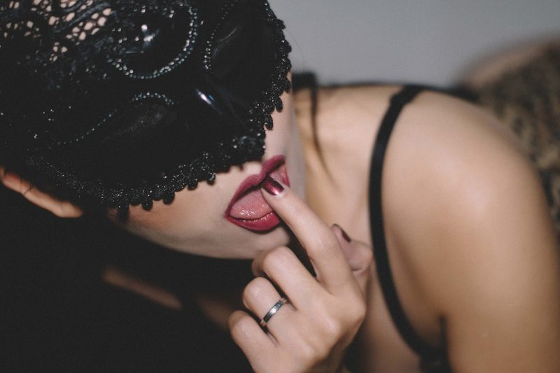 Masked Woman in Bedroom