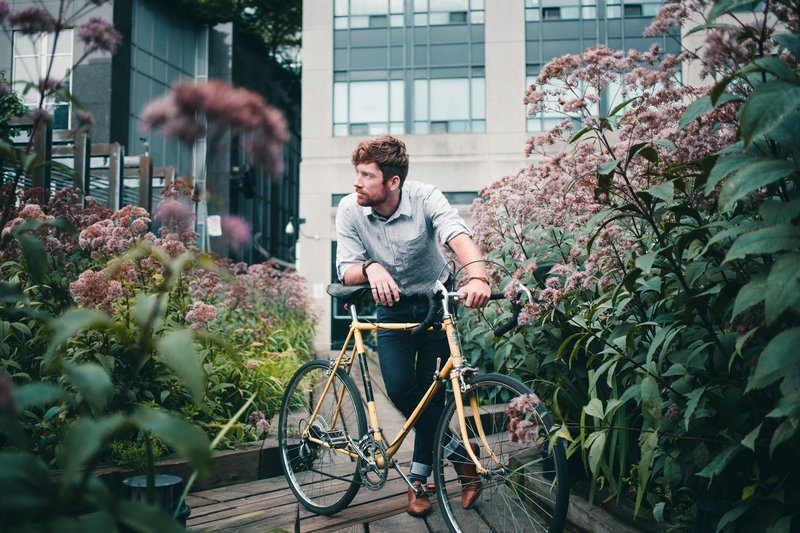 Men's Fashion Man With Bicycle Surrounded By Flowers