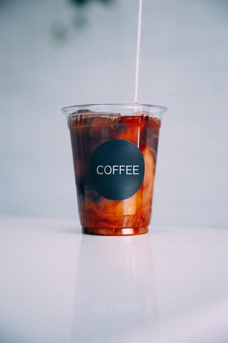 Milk Pouring On Iced Coffee To Go