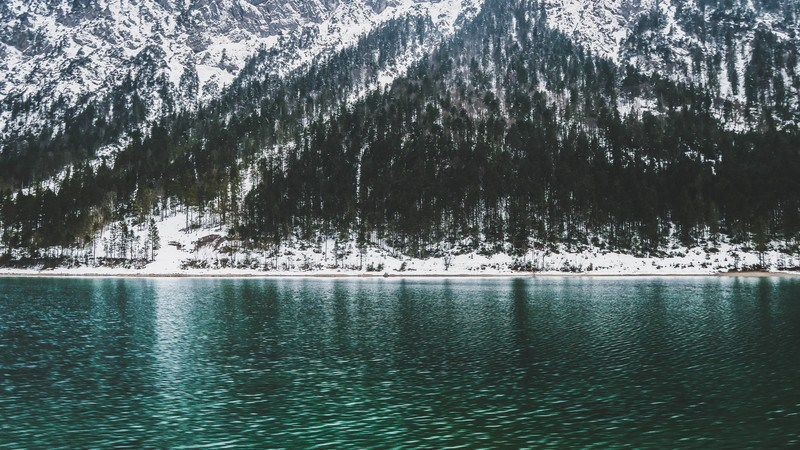 Mountain Covered with Snow Near Water