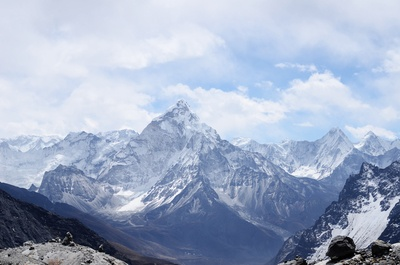 Mountain Range Covered with Snow Under White And