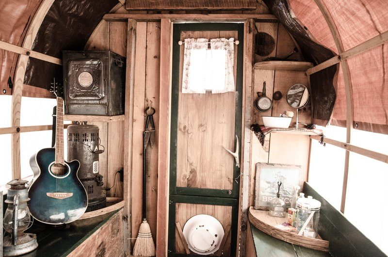 Musical and Rustic Domestic Objects Inside A Caravan