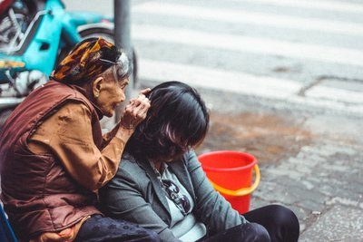 Older Woman Grooming Younger