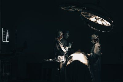 One Surgeon Passes Another A Scalpel