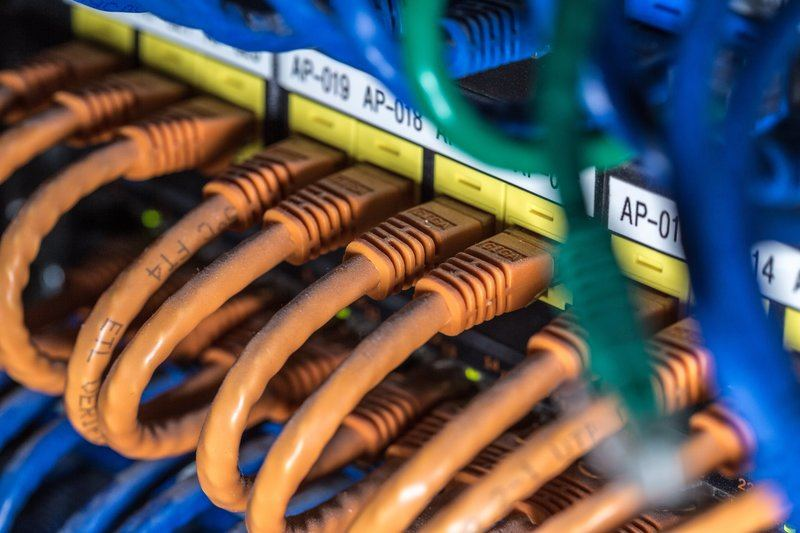 Orange Computer Cables Plugged In