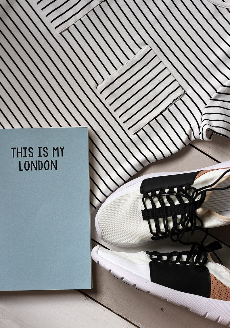 Pair of White-And-Black Sneakers Beside Book