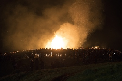 People Gathered Near Bonfire at Nighttime