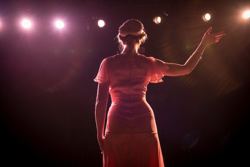 Performer On Stage In Theater Lights