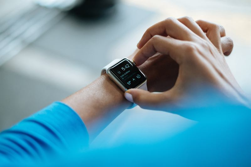 Person Clicking Apple Watch Smartwatch