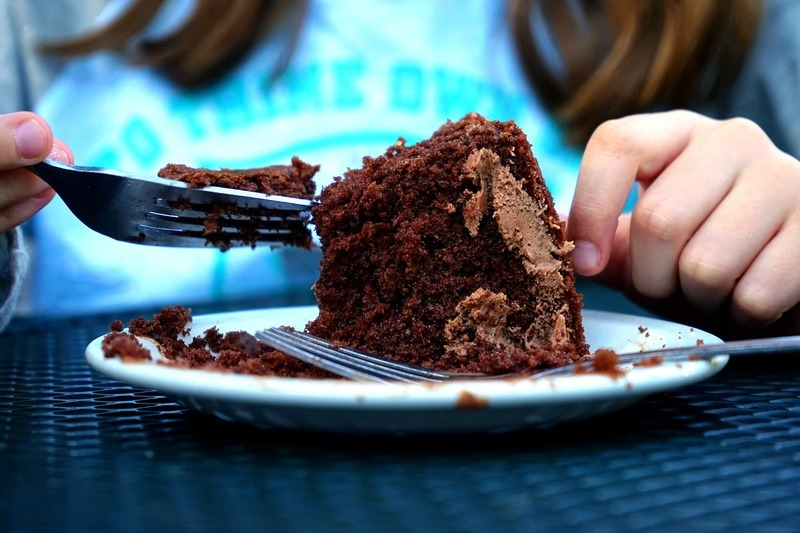 Person Eating Cake