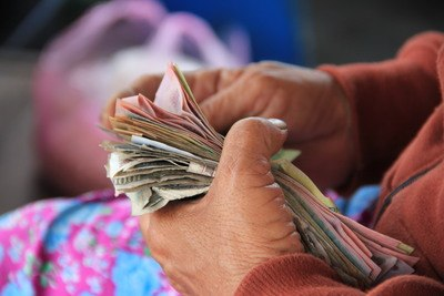Person Holding Banknotes