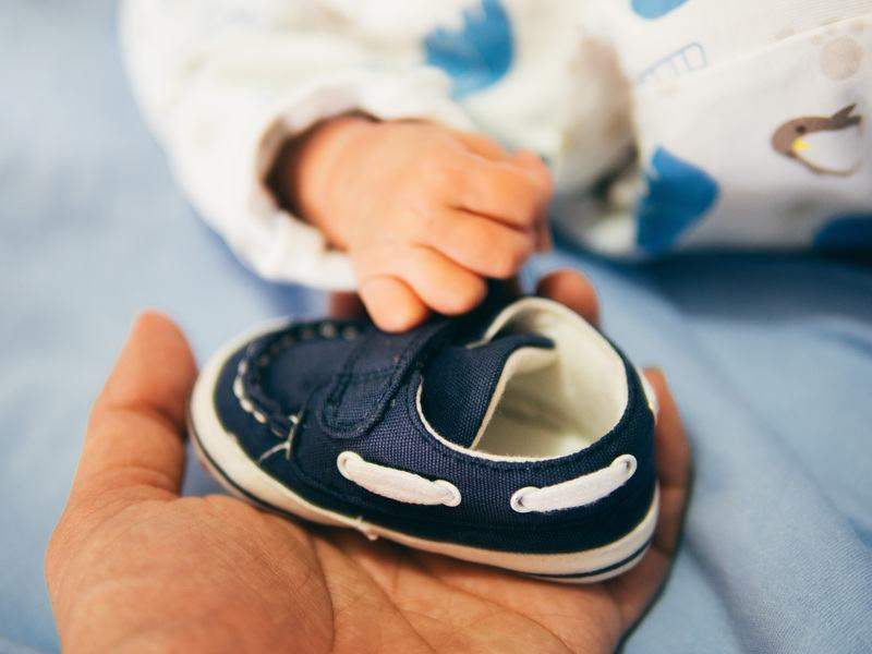 Person Holding Blue Boat Shoe