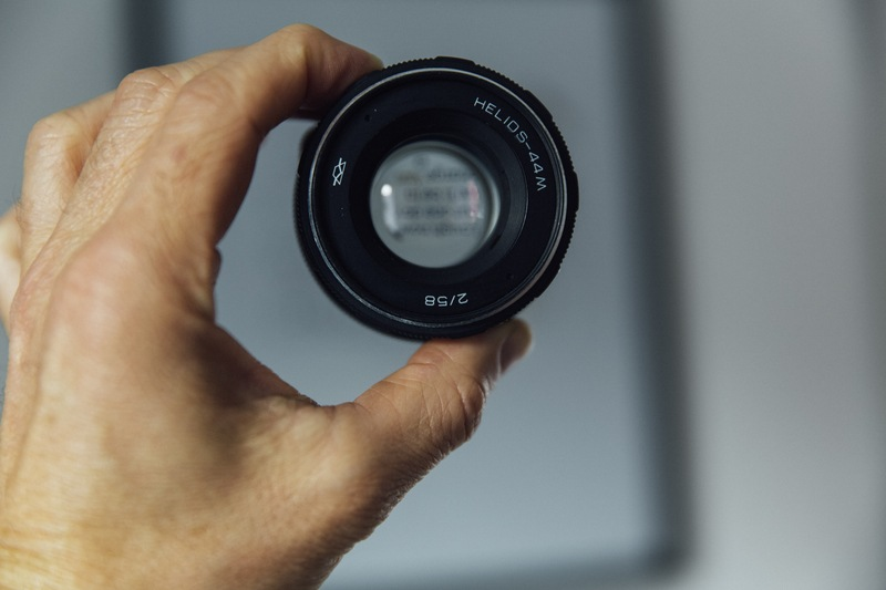 Person Holding Camera Lens