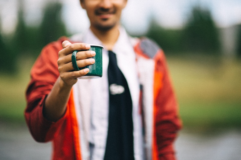 Person Holding Mug in Shallow Focus