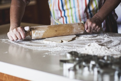 Person Holding Rolling Pin