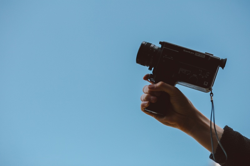 Person Holding a Video Camera