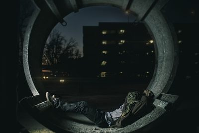 Person Laying inside Hallway with Building As Background