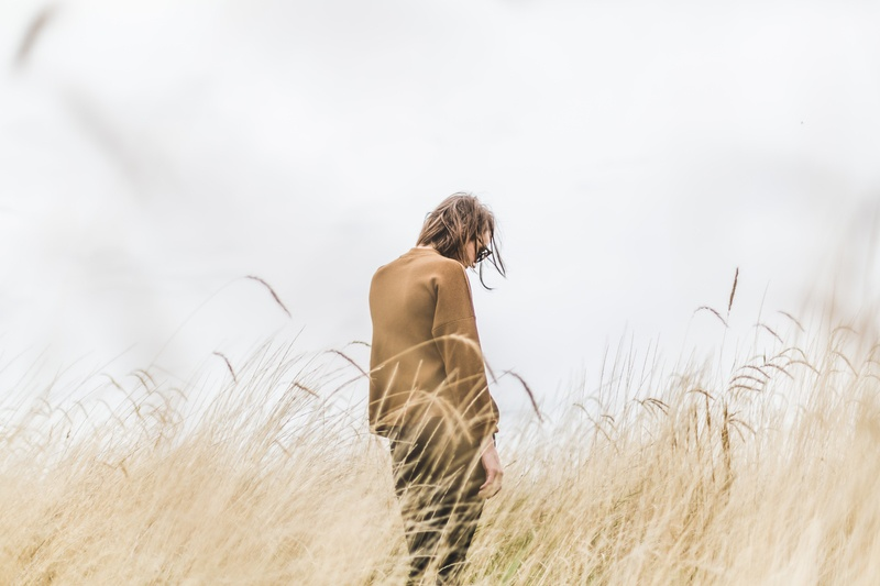 Person Standing in the Middle of Wheat Field