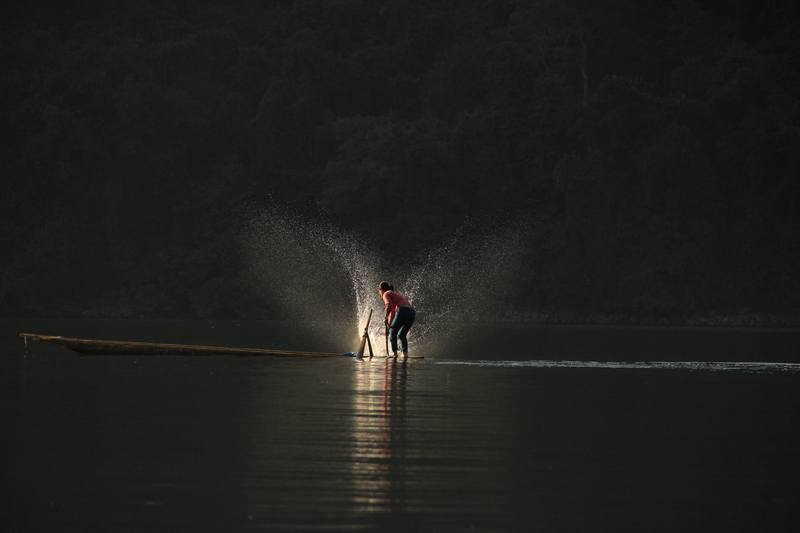 Person Standing on Boat Playing Water