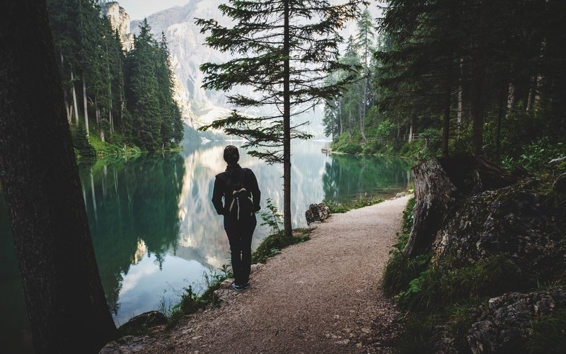 Person Stands Near Lake