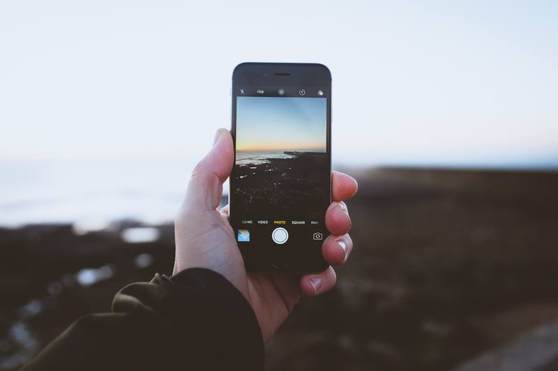 Person Taking  Landscapes Using Iphone