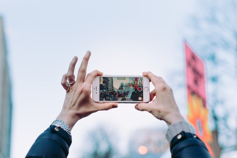 Person Taking Photo Using Iphone 6