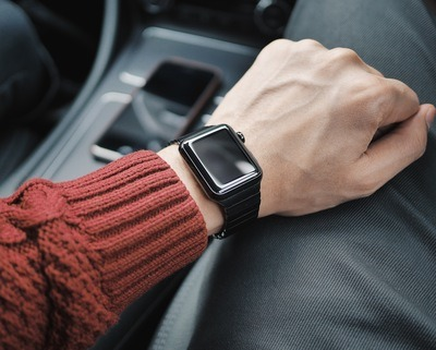 Person Wearing Black Case Apple Watch with White Sport Band
