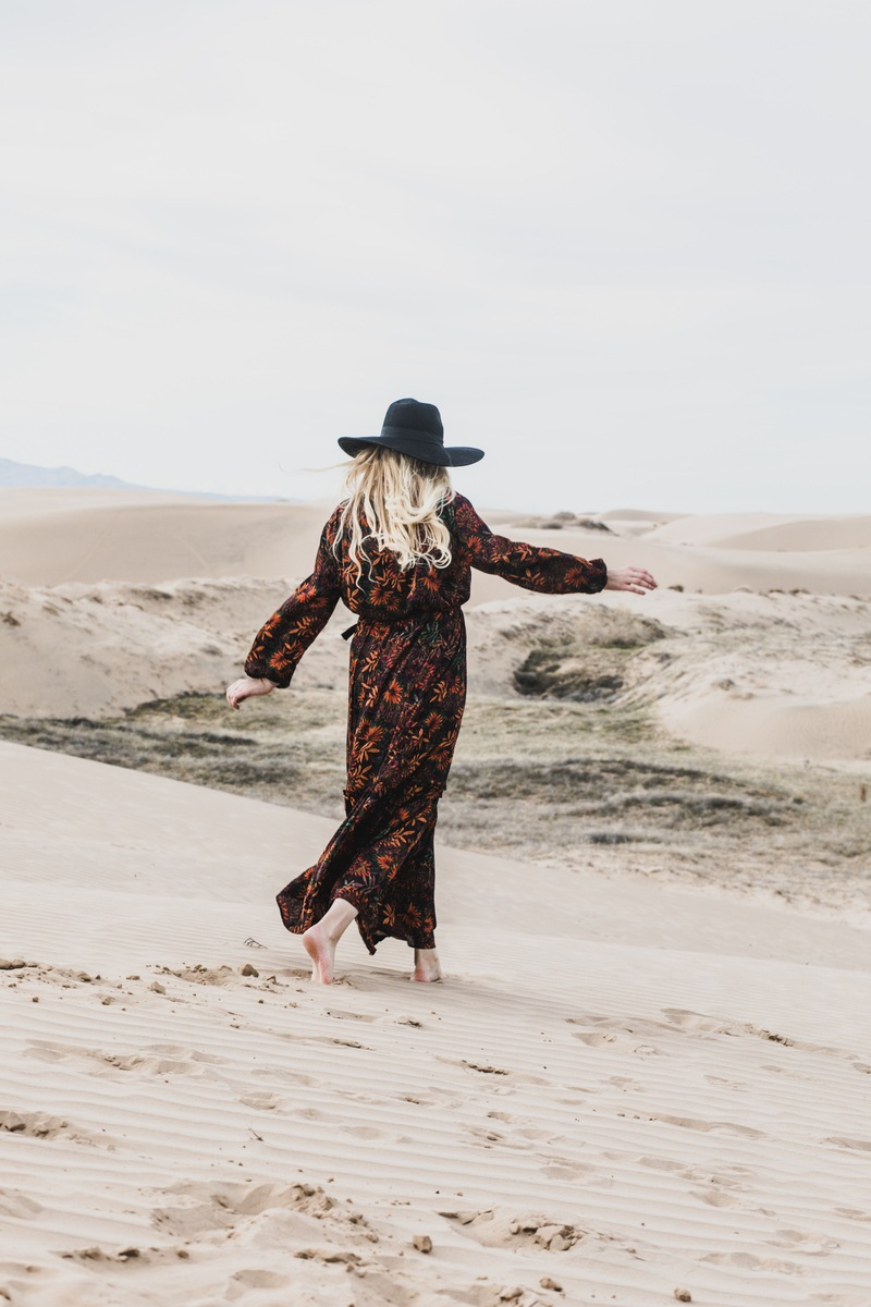 Person Wearing Brown And Orange Floral Maxi Dress Walking