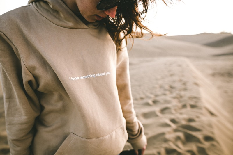 Person Wearing Sunglasses And Hoodie on Sand