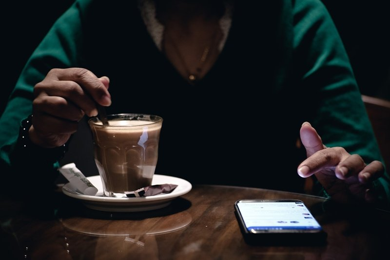 Person With Coffee in Cafe