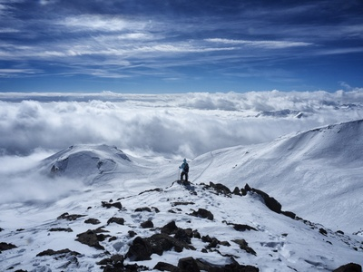 Person on Snow Covered Mountain