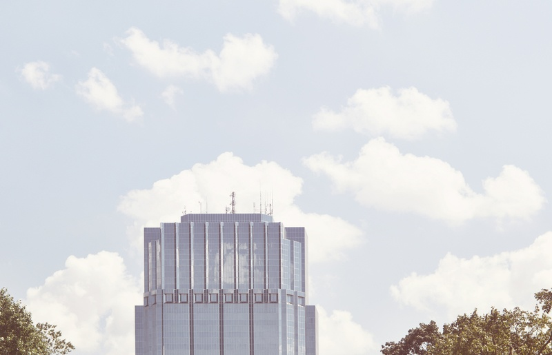 Photography of High-Rise Building with Clouds