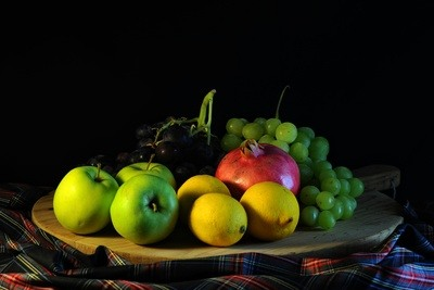 Platter of Fruit with a Black Background