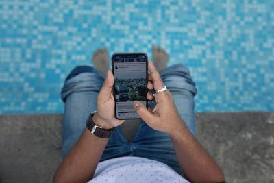 Poolside Using Smart Phone