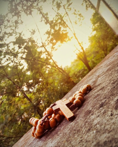 Praying the rosary in the forest
