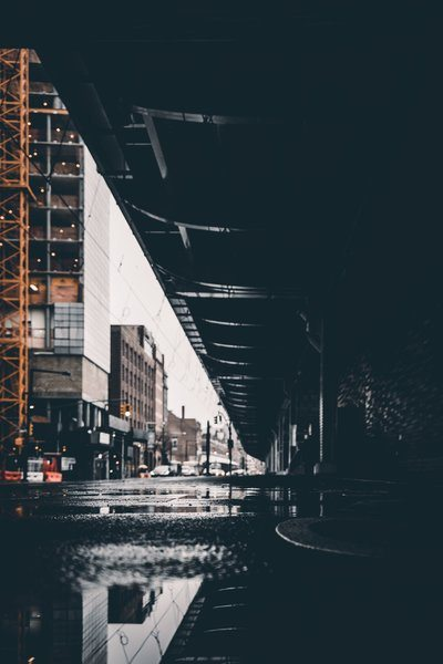 Puddle Water Reflects Urban Bridge